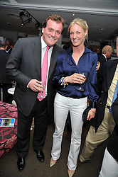 Horse racing figure RICHARD HANNON and his girlfriend JEMIMA ENSOR at the launch of the 2009 Derby Festival in the presence of HRH Princess Haya of Jordan in aid of the charity Starlight held at the Kensington Roof Gardens, 99 Kensington High Street, London W8 on 12th May 2009.
