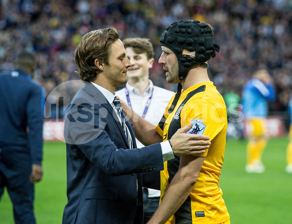 Best of mates Sam Saunders of Wycombe Wanderers and Michael Timlin of Southend United share a moment after the game during the Sky Bet League 2 Play-Off Final match between Southend United and Wycombe Wanderers at Wembley Stadium, London, England on 23 May 2015. Photo by Liam McAvoy.