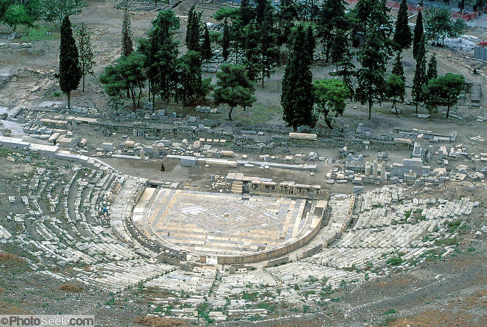 In Athens, Greece, the Theatre of Dionysus Eleuthereus was reconstructed in 342-326 BC including 17,000 open-air seats using Piraeus limestone and marble. This 2001 photo precedes the reconstruction scheduled for 2009-2015.