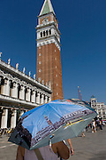 Tourist umbrella beneath the Campanile in Piazza San Marco