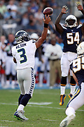 Seattle Seahawks quarterback Russell Wilson (3) throws a pass as Los Angeles Chargers defensive end Melvin Ingram (54) leaps while trying to block it during the 2017 NFL week 1 preseason football game against the against the Los Angeles Chargers, Sunday, Aug. 13, 2017 in Carson, Calif. The Seahawks won the game 48-17. (©Paul Anthony Spinelli)