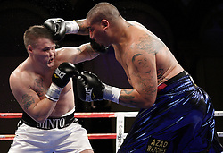 Dec 5, 2009; Atlantic City, NJ, USA; Chris Arreola and Brian Minto trade punches during their heavyweight bout at the Adrian Phillips Ballroom in Atlantic City, NJ. Arreola won via 4th round TKO.