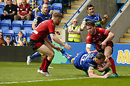 Ben Currie of Warrington Wolves dives over to score the try against Bradford Bulls during the Ladbrokes Challenge Cup match at the Halliwell Jones Stadium, Warrington<br /> Picture by Stephen Gaunt/Focus Images Ltd +447904 833202<br /> 21/04/2018