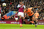 Reading defender Liam Moore (6) heads the ball clear under pressure from Aston Villa striker Jonathan Kodjia (22) during the EFL Sky Bet Championship match between Aston Villa and Reading at Villa Park, Birmingham, England on 3 April 2018. Picture by Dennis Goodwin.