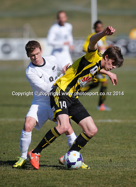 Phoenix's Alex Rufer is tackled by Michael McGlinchey.  New Zealand Select XI v Wellington Phoenix, Owen Delany Park, Taupo, New Zealand. Sunday, 17 August, 2014. Photo: John Cowpland / photosport.co.nz