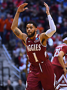 SAN DIEGO, CA - MARCH 16:  Shunn Buchanan #1 of the New Mexico State Aggies celebrates after making a three-pointer against the Clemson Tigers during a first round game of the Men's NCAA Basketball Tournament at Viejas Arena in San Diego, California. Clemson won 79-68.  (Photo by Sam Wasson)