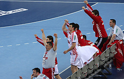 Team of Croatia celebrates during 21st Men's World Handball Championship 2009 Main round Group I match between National teams of France and Croatia, on January 27, 2009, in Arena Zagreb, Zagreb, Croatia.  (Photo by Vid Ponikvar / Sportida)