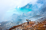 A worker descends into Ijen Volcano in Indonesia.