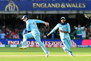 England Are World Champions - Adil Rashid of England and Eoin Morgan of England celebrate as Martin Guptill of New Zealand is run out in the super over and England win the World Cup during the ICC Cricket World Cup 2019 Final match between New Zealand and England at Lord's Cricket Ground, St John's Wood, United Kingdom on 14 July 2019.
