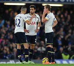 Tottenham Hotspur's Nabil Bentaleb speaks with Tottenham Hotspur's Nacer Chadli and Tottenham Hotspur's Harry Kane - Photo mandatory by-line: Dougie Allward/JMP - Mobile: 07966 386802 - 03/12/2014 - SPORT - Football - London - Stamford Bridge - Chelsea v Tottenham Hotspur - Barclays Premier League