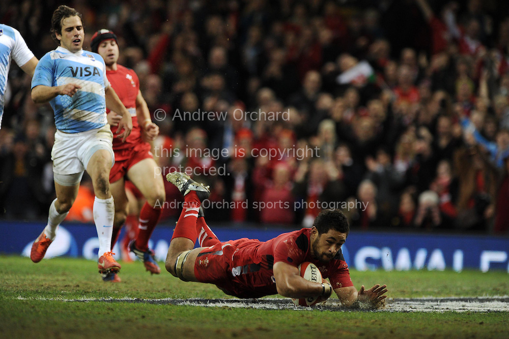 Toby Faletau of Wales dives over to score the 3rd Welsh try. Dove men series, Autumn international, Wales v Argentina at the Millennium stadium in Cardiff , South Wales on Saturday 16th November 2013. pic by Andrew Orchard, Andrew Orchard sports photography,