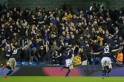 Millwall defender Murray Wallace (25) celebrates his goal in from of the Millwall fans 3-2 during the The FA Cup fourth round match between Millwall and Everton at The Den, London, England on 26 January 2019.