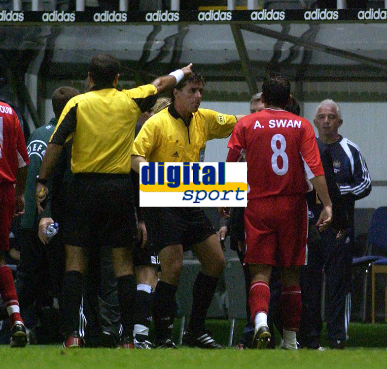 Photo. Glyn Thomas. <br /> Newcastle United v Hapoel Bnei Sakhnin. <br /> UEFA Cup, 1st round, 1st leg. 16/09/2004.<br /> Referee Antonio Costas (L) points Abas Swan back to the dressing room after he refuses to leave the field after a scuffle with Newcastle's Nicky Butt. Butt was also shown the red card<br /> NORWAY ONLY