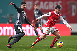 January 13, 2018 - Braga, Braga, Portugal - Braga's Portuguese midfielder Joao Carlos Teixeira (R) in action with Benfica's Portuguese defender Andre Almeida (L) during the Premier League 2017/18 match between SC Braga and SL Benfica, at Municipal de Braga Stadium in Braga on January 13, 2018. (Credit Image: © Dpi/NurPhoto via ZUMA Press)