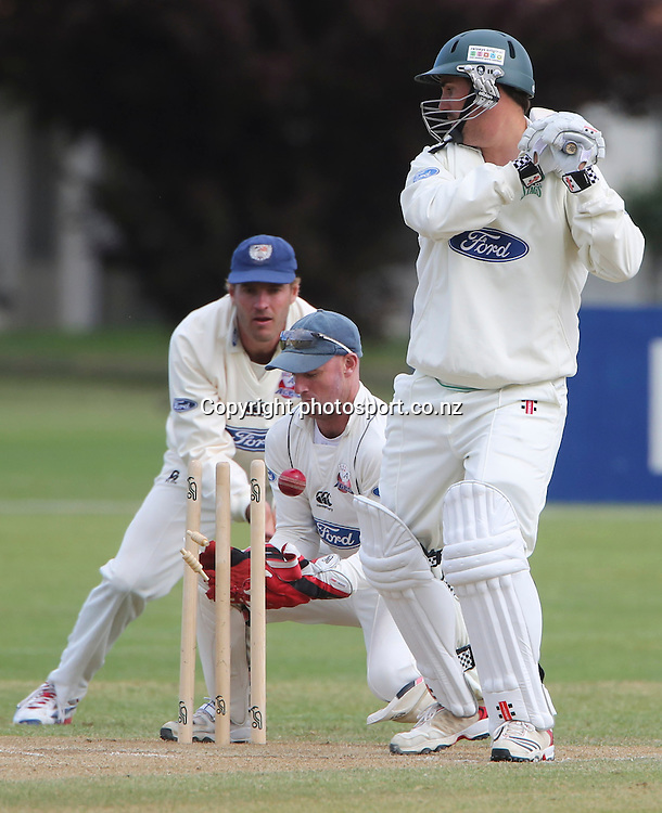 Stag's Mathew Sinclair is caught behind by Aces Gareth Hopkins in the Plunket Shield cricket match between the Central Districts Stags and the Auckland Aces at Nelson Park, Napier,  New Zealand. Wednesday, 07 November, 2012. Photo: John Cowpland / photosport.co.nz