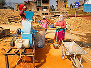 01 MARCH 2017 - BUNGAMATI, NEPAL: Laborers work to rebuild the Rato Machindranath Temple, a 13th century Hindu temple destroyed in the 2015 earthquake. The temple was the most important structure in Bungamati and the center of the community life. Recovery seems to have barely begun nearly two years after the earthquake of 25 April 2015 that devastated Nepal. In some villages in the Kathmandu valley workers are working by hand to remove ruble and dig out destroyed buildings. About 9,000 people were killed and another 22,000 injured by the earthquake. The epicenter of the earthquake was east of the Gorka district.     PHOTO BY JACK KURTZ