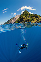 "A Diver does his ""safety stop"" under one of Indonesia's active volcanos, Pulau Komba<br /> <br /> Shot in Indonesia"
