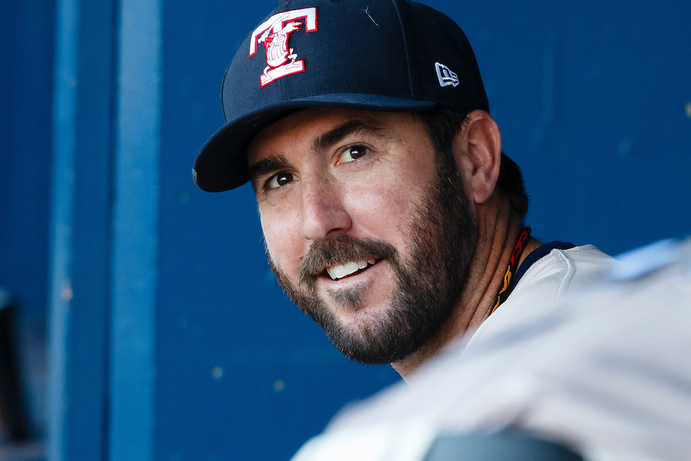 Detroit Tigers pitcher Justin Verlander, playing for the Toledo Mud Hens in a rehab start, sits in dugout before a Triple-A baseball game against the Columbus Clippers in Toledo, Ohio, Saturday, June 6, 2015. (AP Photo/Rick Osentoski)