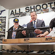 Corey Stewart, center, Chairman of the Board of Supervisors of Prince William County and Virginia Gubernatorial candidate, with assistance from store manager, Walter Kitchen, right, gave away a Smith & Wesson M&P 15 Sport II, an AR-15 rifle, to Rick Thompson, left, at All Shooters Tactical in Woodbridge, Virginia on Wednesday, January 11, 2017.  The Stewart campaign used the AR-15 giveaway as an opportuntiy to tout Stewart's record on support for the second amendment.  John Boal Photography