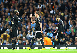 Mario Mandzukic of Juventus celebrates with Paul Pogba during the UEFA Champions League group stage match between Manchester City and Juventus at the Etihad Stadium - Mandatory byline: Matt McNulty/JMP - 07966386802 - 15/09/2015 - FOOTBALL - Etihad Stadium -Manchester,England - Manchester City v Juventus - UEFA Champions League - Group D