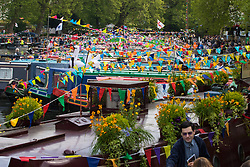 Little Venice, London, April 30th 2017. Narrowboaters from all over the uK gather for the annual Canalway Cavalcade, held on the May Day Bank holiday weekend, organised by the Inland Waterways Association, where boaters get the chance to display their immaculately prepared and brightly painted craft as well as compete in various manoeuvring tests. PICTURED: Brightly coloured bunting catcher the morning sunlight.<br /> Credit: ©Paul Davey<br /> To licence contact: <br /> Mobile: +44 (0) 7966 016 296<br /> Email: paul@pauldaveycreative.co.uk<br /> Twitter: @pauldaveycreate