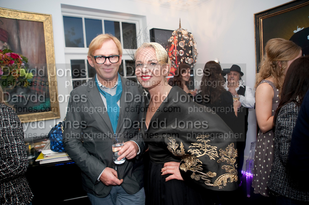DAVID COLLINS; AMANDA ELIASCH, Party at the home of Amanda Eliasch in Chelsea after the opening of As I Like it. A memory by Amanda Eliasch and Lyall Watson. Chelsea Theatre. Worl's End. London. 4 July 2010<br /> <br />  , -DO NOT ARCHIVE-© Copyright Photograph by Dafydd Jones. 248 Clapham Rd. London SW9 0PZ. Tel 0207 820 0771. www.dafjones.com.