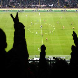 MILAN, FEBRUARY 26: Supporters cheering during Italian Championship soccer game, AC Milan - Juventus on february 26, 2012 in Milan