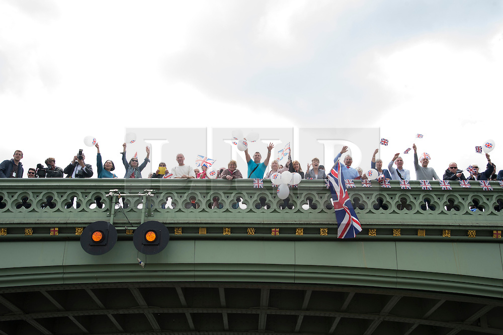 © Licensed to London News Pictures. 15/06/2016. UKIP supporters on Westminister Bridge wave a pro-Brexit flotilla of boats going down the River Thames urging voting in the British EU Referendum.  London, UK. Photo credit: Ray Tang/LNP