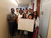 All the interns with a Get Well Soon card for their teacher, Lisa Mangum. Front row: Keiara, Lauren. Second row: Ezekiel, Jarena, Anibal, Josh, and HISD teacher assistant Rochelle Wright. Back row: Abel, Danielle, Rodolfo, and Jess. Not visible: Mi'chael'la.