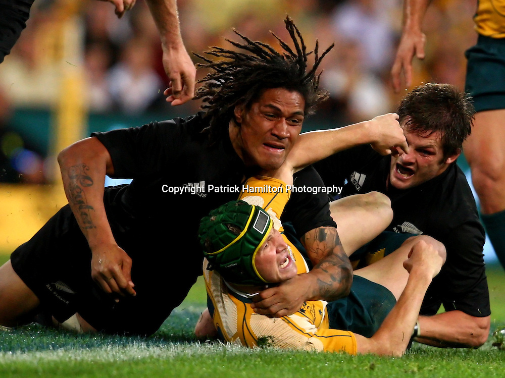 Matt Giteau is tackled by Rodney So'oialo & Richie McCaw.All Blacks v Australia Tri Nations Rugby Union Test Match. Suncorp Stadium ,Brisbane. Australia,Saturday 13 September 2008 . Photo: PHOTOSPORT
