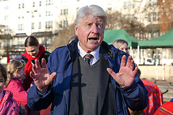 © Licensed to London News Pictures. 04/12/2019. London, UK. Author and father of the Prime Minister BORIS JOHNSON, STANLEY JOHNSON speaks at unveiling of life-sized herd of 21 bronze elephants at Marble Arch.<br /> Children unveil a herd of 21 bronze elephants at Marble Arch. The sculpture is the largest such depictionof an elephant herd in the world and is intended to draw attention to the plight of this species that could be extinct on current trends, by 2040. Each elephant in the sculpture is modelled after a real orphaned animal currently in the care of the Sheldrick Wildlife Trust. Left behind by poachers and other sources of human-wildlife conflict these animals have been raised by the trust in an effort to secure the future of the species. The herd will be displayed until 4 December 2020. Photo credit: Dinendra Haria/LNP
