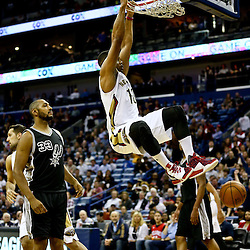 Mar 3, 2016; New Orleans, LA, USA; New Orleans Pelicans guard Eric Gordon (10) dunks over San Antonio Spurs center Boris Diaw (33) during the first quarter of a game at the Smoothie King Center. Mandatory Credit: Derick E. Hingle-USA TODAY Sports