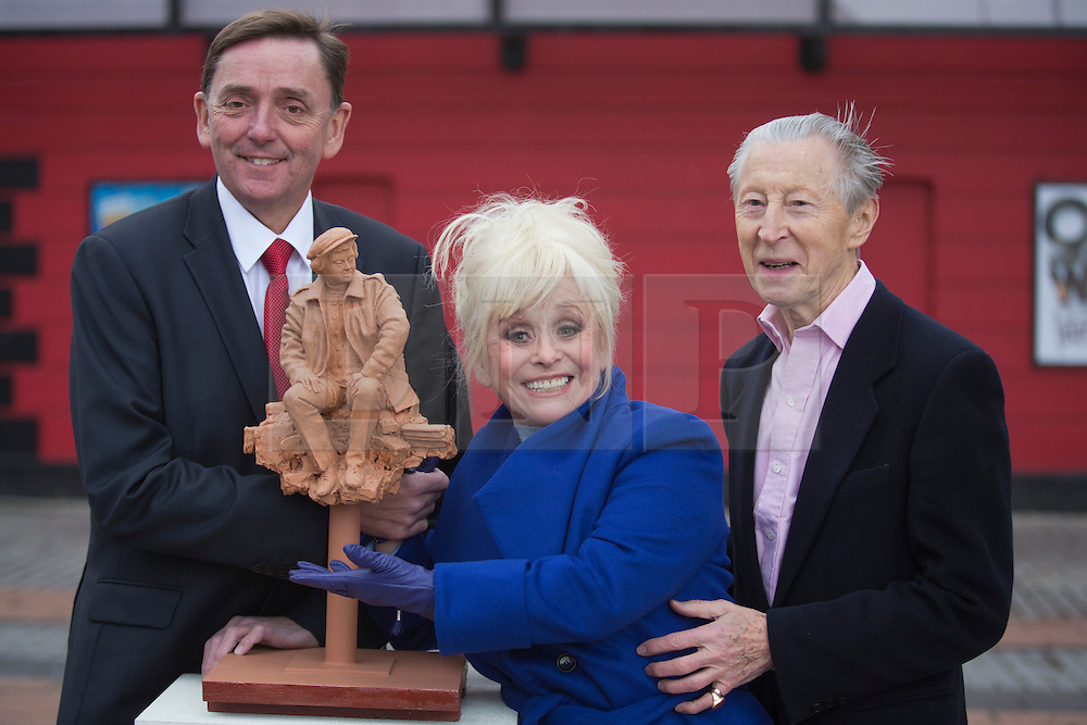 © Licensed to London News Pictures. 21/11/2013. London, England. Pic: Barbara Windsor with Sir Robin Wales, Mayor of Newham (l), and actor Murray Melvin (r). Barbara Windsor has joined Theatre Royal Stratford East's fundraising campaign to build a sculpture for the legendary director Joan Littlewood with whom she worked during the early stages of her career. The theatre launches a public appeal to raise the final 40% needed (c. £60,000) to commission Philip Jackson to created the bronze sculpture which is due to be installed in Theatre Square, Stratford in spring 2014. Photo credit: Bettina Strenske/LNP