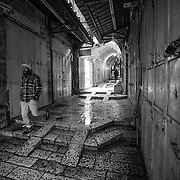 A man walks in the rain on David Street in The Old City on January 7, 2015 in Jerusalem, Israel. (Photo by Elan Kawesch)