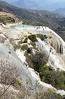 "The mineral springs of Hierve el Agua have formed ""petrified waterfalls"" on the cliff face."