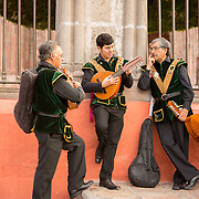 Musicians await a soon-to-be married couple at the Parroquia in San Miguel de Allende, Mexico for a wedding procession.