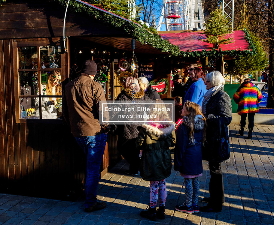 Edinburgh's Christmas 2019: People shopping at a stall in Princes Street Gardens.