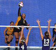 Janesville's Olivia Fisher (15) goes up for a kill over Stanton's Carmen Subbert (4) and Kadie Subbert (13) during the second game of their 1A semifinal match in the state volleyball tournament at the U.S. Cellular Center at 370 1st Ave E on Friday evening, November 12, 2010. (Stephen Mally/Freelance)