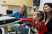 Dr. Leslie Hays performs a well child check-up on 17-month old Alyssa Lee Martinez while her mother Bernadette Martinez at El Centro Family Health in Española New Mexico on Friday, Oct. 14, 2016.