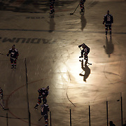 New York Islanders players during warm up at Yankee Stadium before the New York Rangers Vs New York Islanders  NHL regular season game held outdoors at Yankee Stadium, The Bronx, New York, USA. 29th January 2014. Photo Tim Clayton
