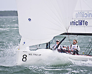 MIAMI - OCTOBER 30, 2011.  Skipper Anna Tunnicliffe and crew Molly Vandemoer and Debbie Capozzi surf to the finish that wins the regatta.  The team now qualifies to race in the second trials in May in Weymouth UK, the Perth 2011 ISAF Sailing World Championships, and the first three of the 2012 ISAF World Cup events.
