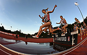 May 2, 2019; Stanford, CA, USA; Runners racer over the water jump in the women's steeplechase during the 24th Payton Jordan Invitational at Cobb Track & Angell Field.