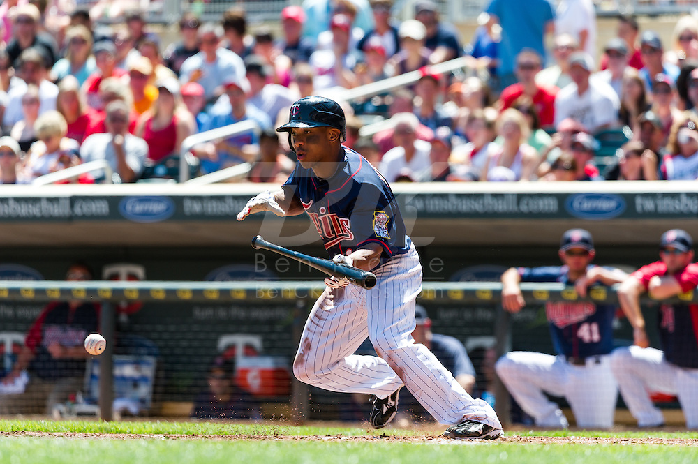 Minnesota Twins right fielder Ben Revere bunts during a game against the Cleveland Indians at Target Field in Minneapolis, Minnesota on July 29, 2012.  The Twins defeated the Indians 5 to 1.  © 2012 Ben Krause