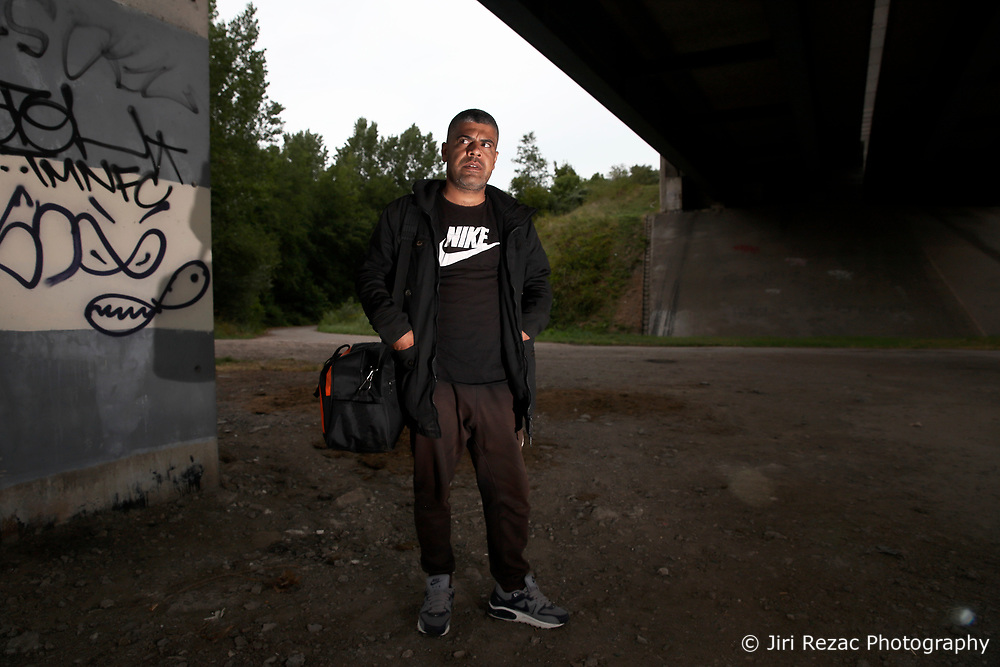 FRANCE GRANDE SYNTHE 2AUG17 - Iraqi Kurd Ismhel Dishad, 34, formerly an Iraq army corporal stands under a motorway bridge near the unofficial Jungle II camp near Grande Synthe, Dunkirk, northern France.<br /> <br /> He has travelled via Turkey, Macedonia, Serbia, Croatia, Slovenia, Austria, Germany to reach the camp where he has been stranded for 5 months.<br /> <br /> jre/Photo by Jiri Rezac<br /> <br /> &copy; Jiri Rezac 2017