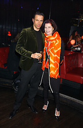 NATHALIE HAMBRO and ANDREAS SIEGFRIED at the 40th birthday party and celebration of 20 years as a leading stylist of David Thomas held at Too2Much club, 11 Walkers Court, London W1 on 22nd March 2006.<br />