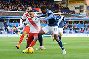 Charlton Athletic defender Tareiq Holmes-Dennis tackles Birmingham City midfielder Jacques Maghoma during the Sky Bet Championship match between Birmingham City and Charlton Athletic at St Andrews, Birmingham, England on 21 November 2015. Photo by Alan Franklin.