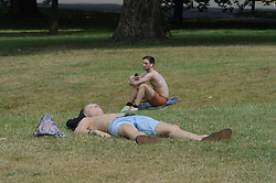 © Licensed to London News Pictures. 24/06/2014. People sunbathe in Greenwich Park during sunny weather, today 24th June 2014. Byline:Grant Falvey/LNP