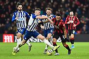 Callum Wilson (13) of AFC Bournemouth battles for possession with Adam Webster (15) of Brighton and Hove Albion during the Premier League match between Bournemouth and Brighton and Hove Albion at the Vitality Stadium, Bournemouth, England on 21 January 2020.