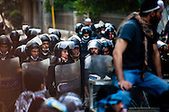 Protestors hold back the crowd from clashing with the police on Mohamad Mohamad street during a truce between the police and the protestors brokered by religious leaders and the military. Street battles raged around the heavily fortified Interior Ministry, near Tahrir square, with police and army troops using tear gas and rubber bullets to keep the protesters from storming the ministry..The clashes have left at least 38 killed and 2,000 protesters wounded, mostly from gas inhalation or injuries caused by rubber bullets fired by the army and the police. The United Nations strongly condemned what it called the use of excessive force by security forces.