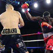 Zhilei Zhang of Zhoukou, China (L) fights Curtis Harper of Jacksonville, Florida during a Nelsons Promotions boxing match at the Boca Raton Resort  and Club on Friday, May 26, 2017 in Boca Raton, Florida.  (Alex Menendez via AP)